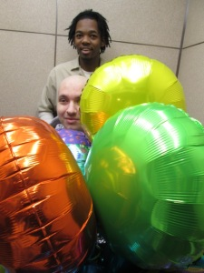 JJ in the elevator with his balloons.