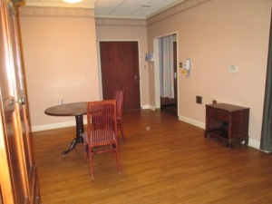 This was where board meetings were held. The door leads into the hallway. JJ's room is through the doorway at the right.