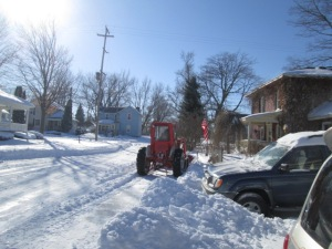 Our neighbor plowing near our stone wall where we often park.
