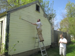 EJ and JJ helping paint the garage.