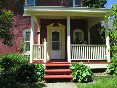 Cream and red--the porch is now completely painted.