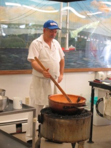 The Owner of the Fort Fudge Shop making fudge.