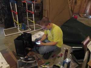 JJ building his computer in the garage.