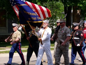 Veterans walking to the cemetery on Memorial Day 2012