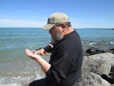 EJ looking at stones