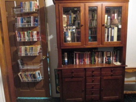 Door into the living room has more shelves...and my china cabinet holds favorite books