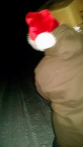 Santa Jared carrying my package through the cold snowy night.