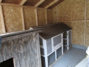 The chicken and duck coops fit nicely in the shed.