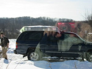 Our mattress on top of the Suburban--with my reflection in the window.