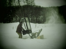 EJ snowblowing our driveway