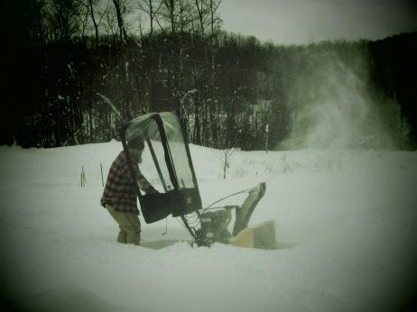 EJ snowblowing our driveway
