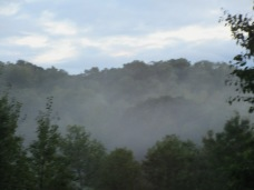 Mist rising from the hills across the road.